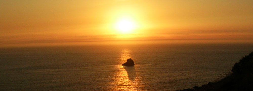 Finisterre sunset by Galicia Tours